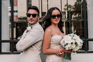 newly wed couples wearing sunglasses in wedding outfits