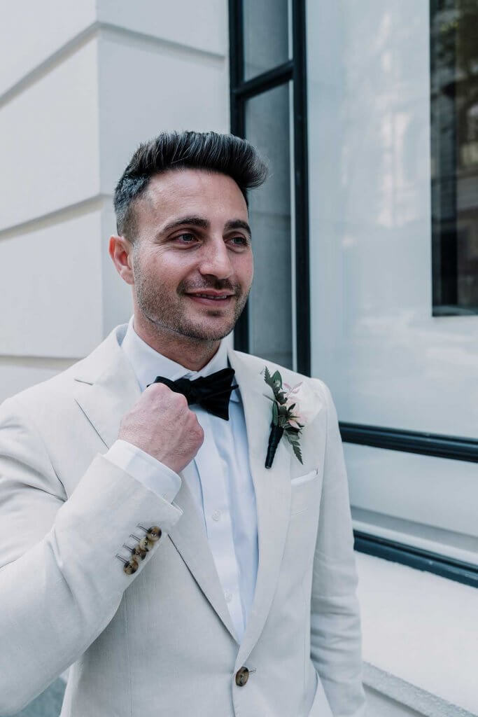 wedding groom in awesome elegant white suit shot by Black Avenue Productions