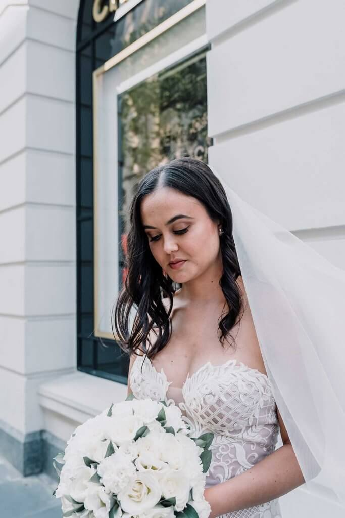 wedding bride in awesome elegant white suit shot by Black Avenue Productions