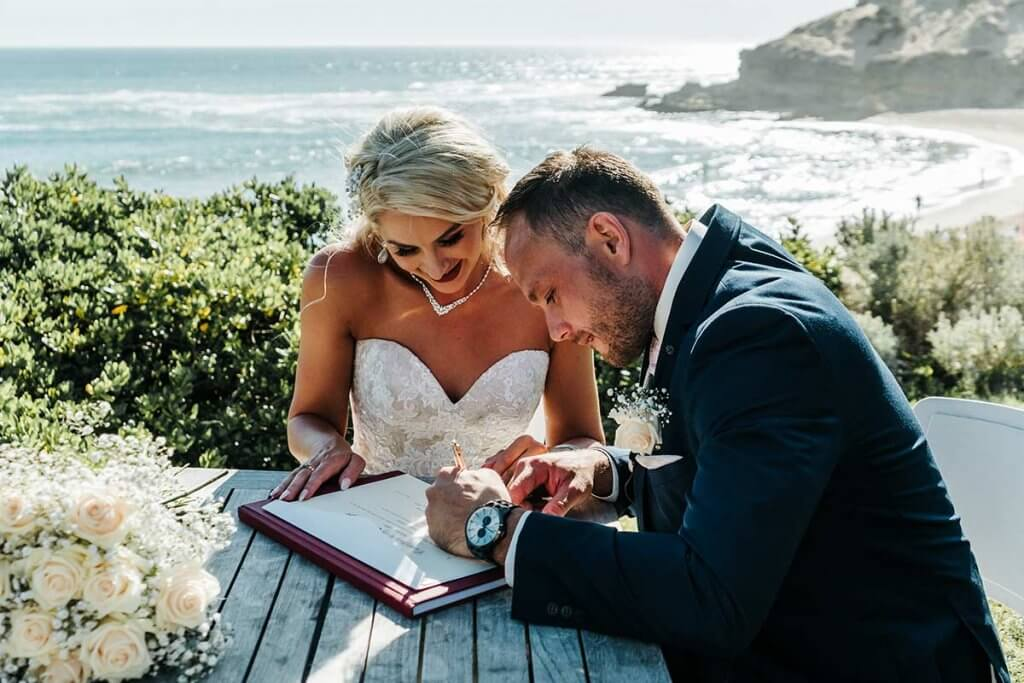 lovely couple signing their marriage contract