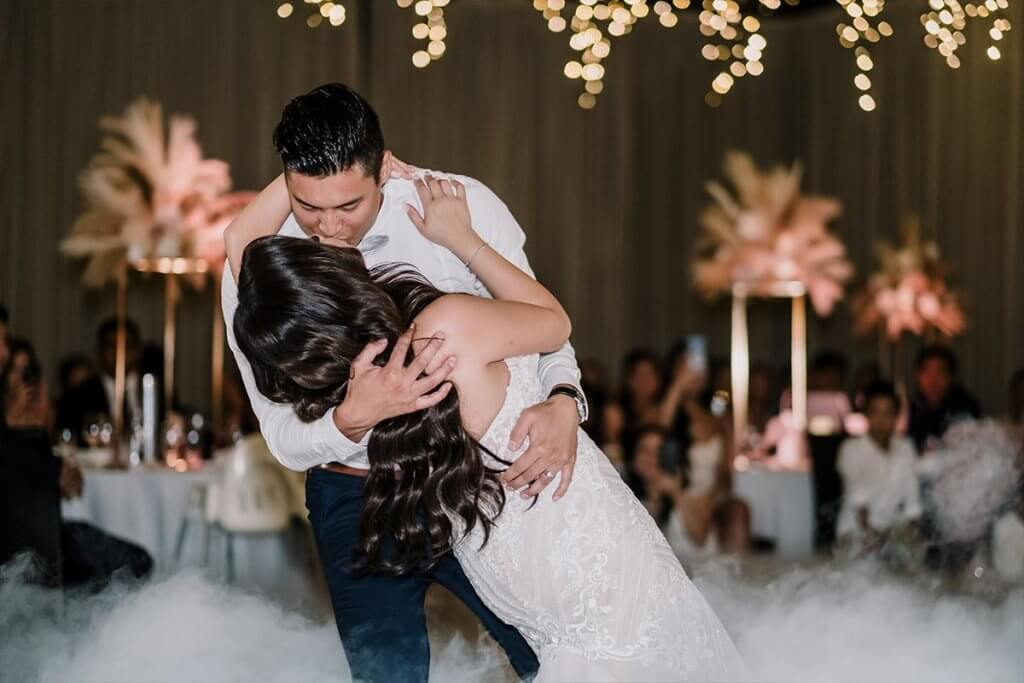 newlywed's first dance with kiss