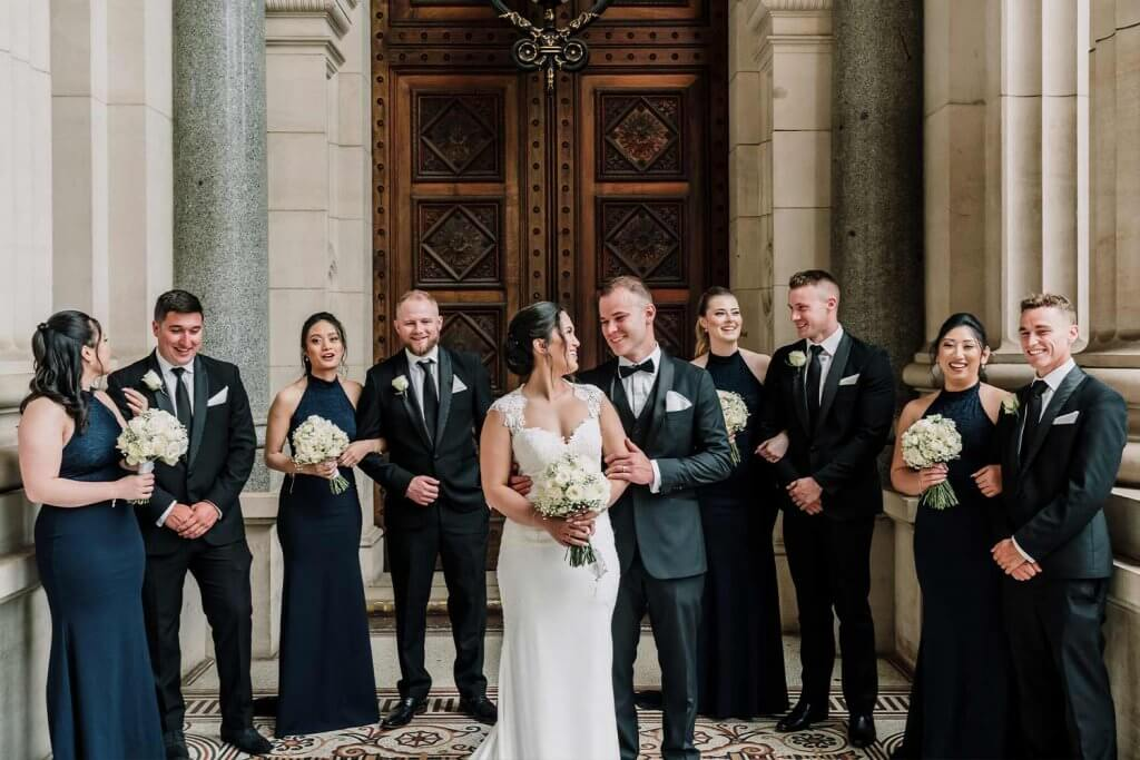 Bride and Groom with their Groomsmen and Bridesmaid in church entrance
