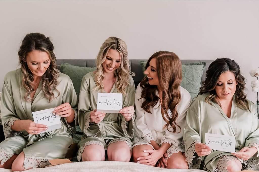 Bridesmaid and Bride wearing robes