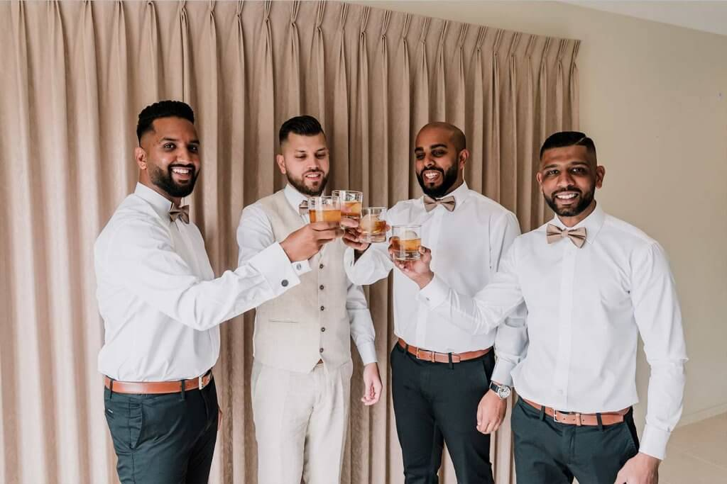 Groomsmen with Groom drinking champagne