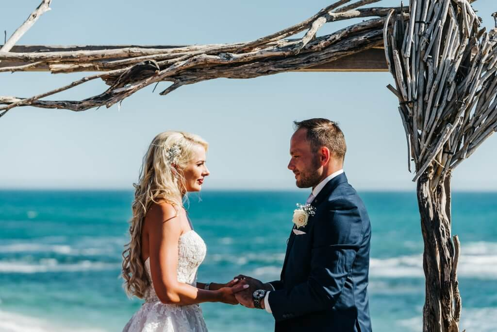A lovely couple exchanging vows by the sea
