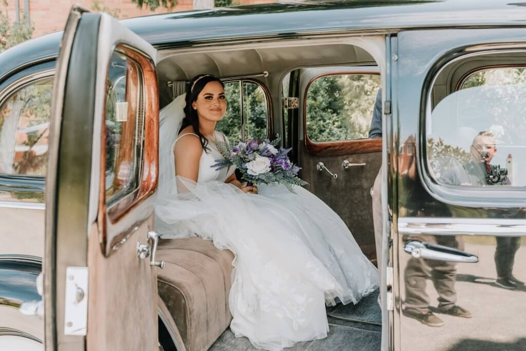 The beautiful bride photographed inside the bridal car