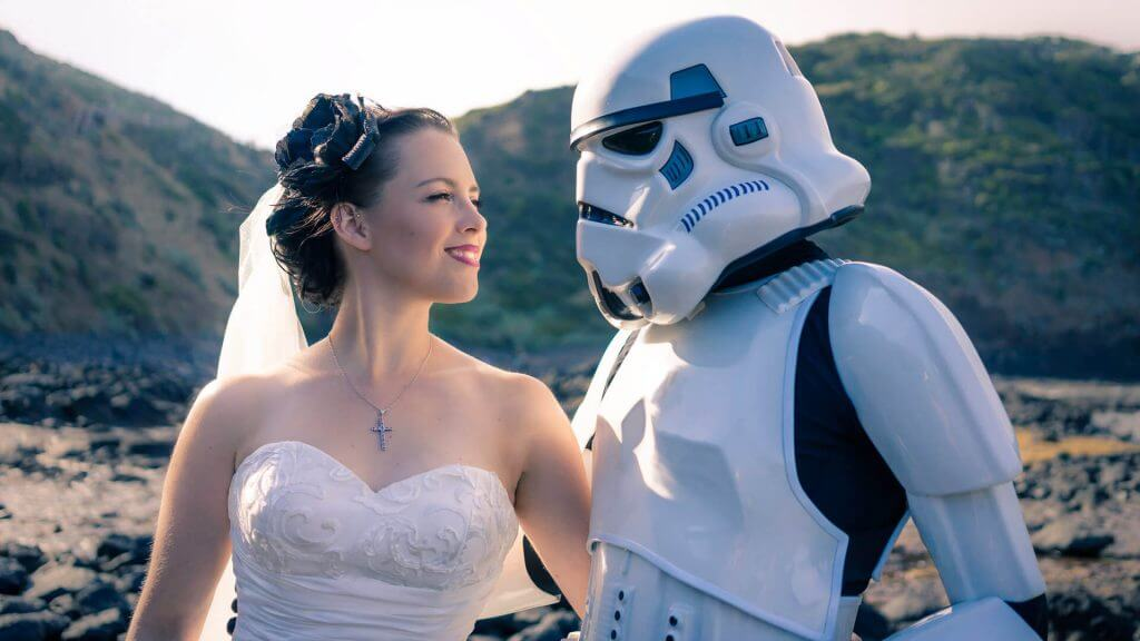 Black Avenue Productions took the image of a storm trooper looking at his stunning wife in her sweetheart neckline wedding dress in Mornington peninsula